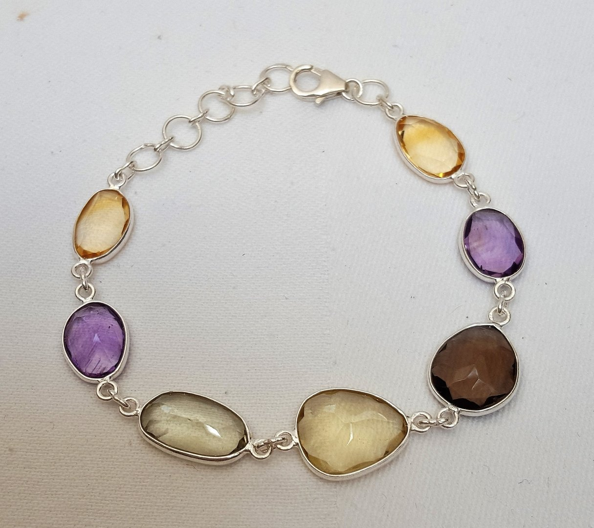 CITRINE, AMETHYSTE,QUARTZ FUME, HIDDENITE - bracelet formé de 7 pierres naturelles facettées,